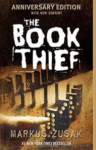 eThe Book Thief by Markus Zusak (coer) Image: a sepia tone picture of a hand pushing over a line of dominoes