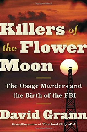 Killers of the Flower Moon by David Grann (cover) White text over a reddish and dark background