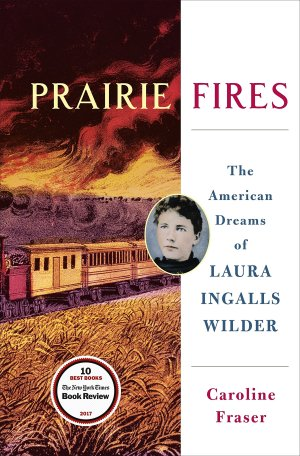 Prairie Fires by Caroline Fraser (cover) Image: a train rolls across a midwest prairie