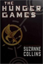 The Hunger Games by Suzanne Collins (cover) Image: white text and a gold mockingbird symbol on a black background
