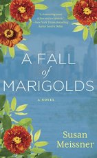 A Fall of Marigolds by Susan Neissner (cover) White test on a blue background vordered on three corners with marigolds
