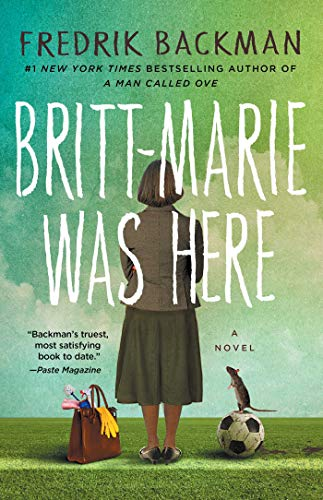 Britt-Marie Was Here by Fredrik Backman (cover) Image: a woman stands on a sidewalk with her back to the camera, a valise and soccer ball at her feet