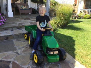 boy and tractor toy