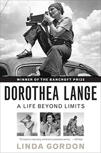 Dorothea Langue: A Life Behond Limits by Linda Gordon (cover) Image: a woman sits on top of a car looking through a camera lens