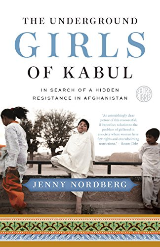 The Underground Girls of Kabul by Jenny Nordberg (cover) Image: school age kids hanging around next to a wall
