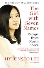 The Girl With Seven Names by Hyeonseo Lee (cover) Image: red and black text down the right side and the portrait of a young Korean girl on the left