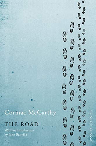 The Road by Cormac McCarthy (cover) Image: footprints run vertically up the right side of the blue cover