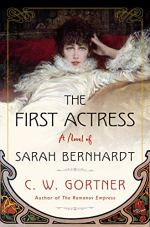 the First Adtress by C.W. Gortner (image: a sultry Bernhardt dressed in a gown with feathers reclines on a white cushion)