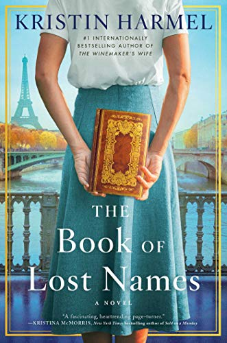 The Book of Lost Names by Kristin Harmel (cover) Image: a young woman holds an old book in her hands with her hands behind her back and back to the camera