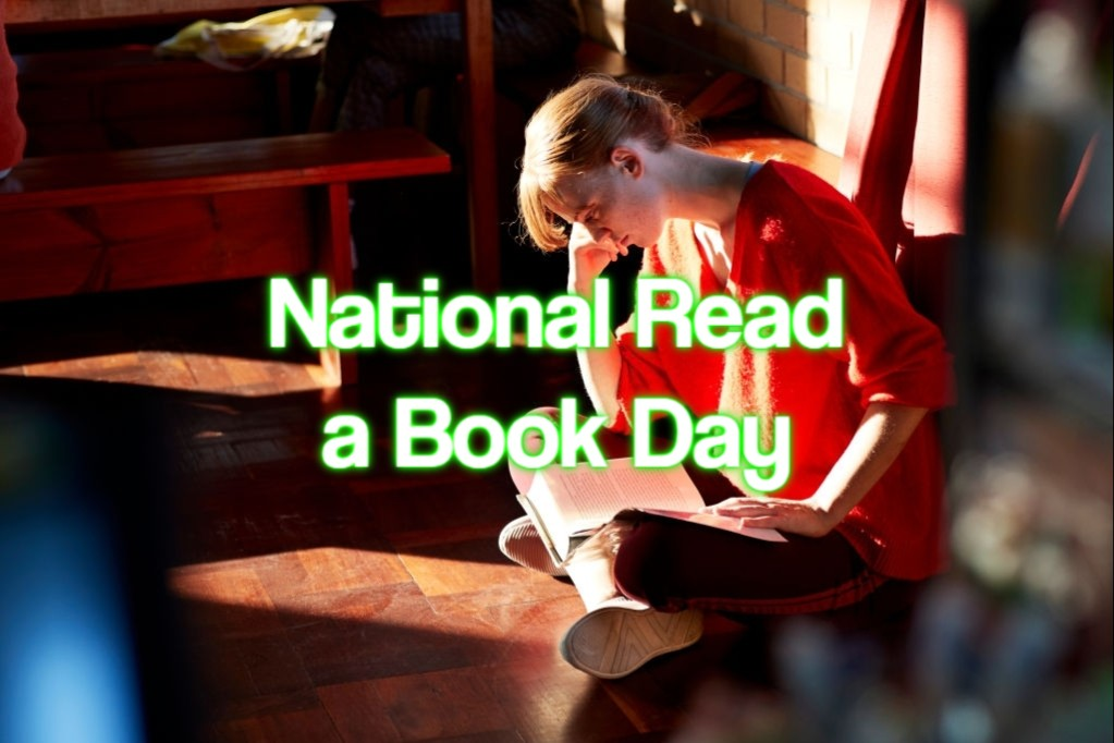 National Read a Book Day (Image: White text over a background image of a young woman sitting cross legged on the floor reading a book)