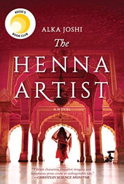 The Henna Artist by Alka Joshi (cover) Image: a woman in cultural dress walks through (what looks like) an open air palace entrance