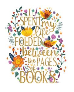 I spent my life folded between the pages of books (words surrounded with a border of flowers)