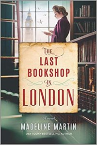 The Last Bookshop in London by Madeline Martin (cover) Image: a young woman stands near shelf lined books next to a window holding an open book