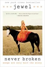 Never Broken by Jewel (cover) Image: Jewel wears a orange dress and sits bareback and barefoot on the back of a black horse in the middle of a field