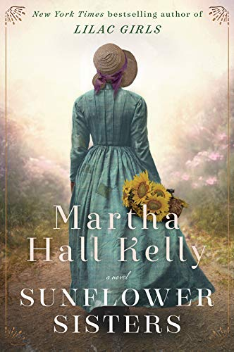 Sunflower Sisters by Martha Hall Kelly (cover) Image: a young woman in a long blue dress and bonnet walks down a country road with a handful of large sunflowers
