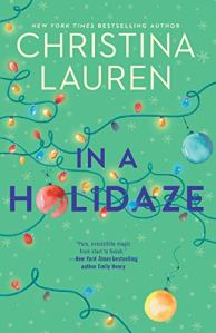 IN a Holidaze by Christina Lauren (cover) Image: title plus  a string of colorful Christmas lights