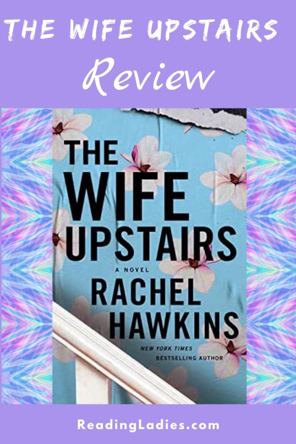 The Wife Upstairs by Rachel Hawkins (cover) Image: a glimpse of a while railing, black text on blue wallpaper with light pink flowers scattered around