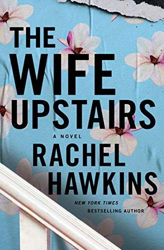 The Wife Upstairs by Rachel Hawkins (cover) Image: a glimpse of a while railing, black text on a blue paneled wall...light pink flowers scattered around