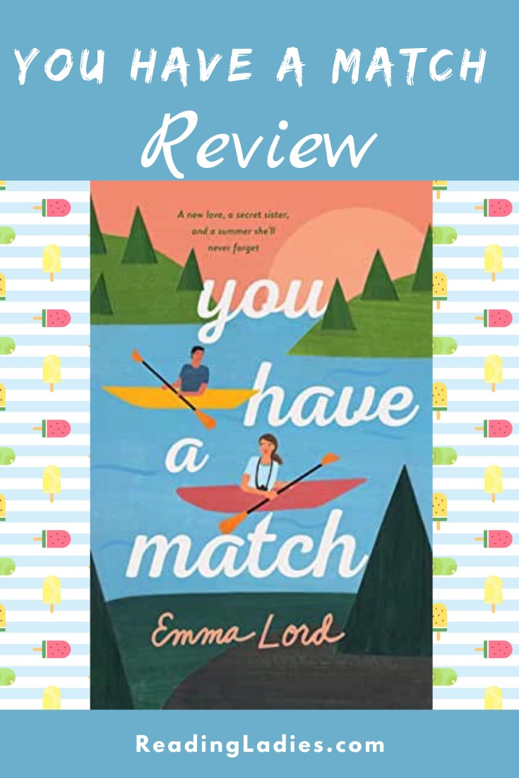You Have a Match by Emma Lord (cover) Image: a boy and a girl paddle in separate boats on a lake surrounded by green hills and pine trees