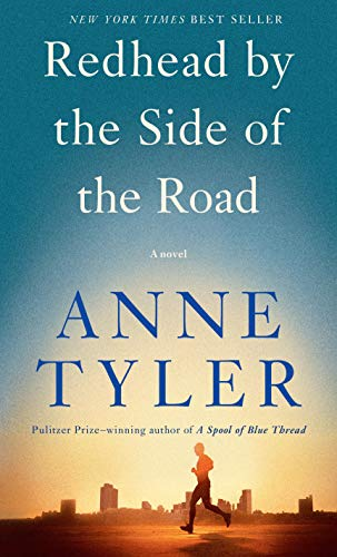 Redhead By the Side of the Road by Anne Tyler (cover) Image: a man runs on the street with a cityscape in the background