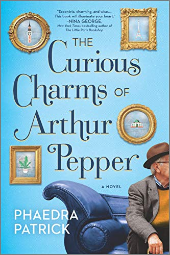 The Curious Charms of Arthur Pepper by Phaedra Patrick (cover) Image: an older man sits on the edge of a blue sofa, framed pictures hang on a blue wall