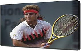 Tennis pro, Andre Agassi holding a racket waiting for a serve