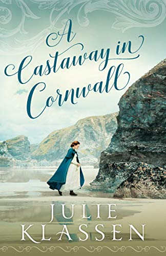 A Castaway in Cornwall by Julie Klassen (cover) Image: a woman in a long white dress and blue cape walk along the cliffs at the ocean's edge
