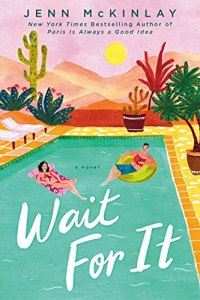 Wait For It by Jenn McKinlay (cover) Image: a young man and young woman float in a pool surrounded by a desert landscape