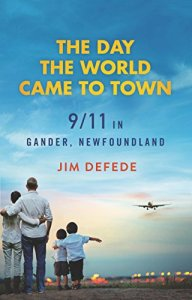 The Day the World Came to Town by Jim Defede (cover) Image: a family of four (2 adults and 2 children) stand with their back to the camera watching a jetliner land